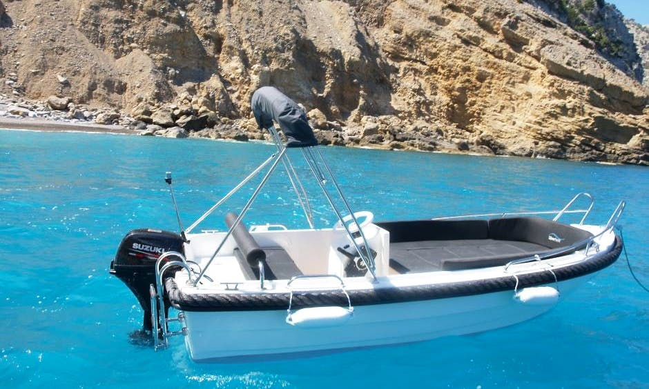 Become a skipper of a sleek and stylish boat in Port d'Alcúdia, Spain!