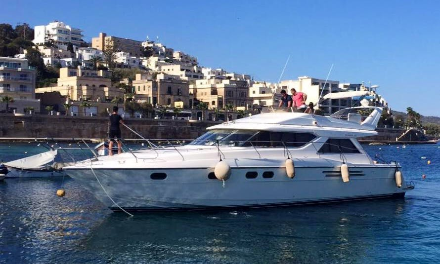 Enjoy With Friends And Family On This 12 Persons Motor Yacht Charter in San Pawl il-Baħar, Malta