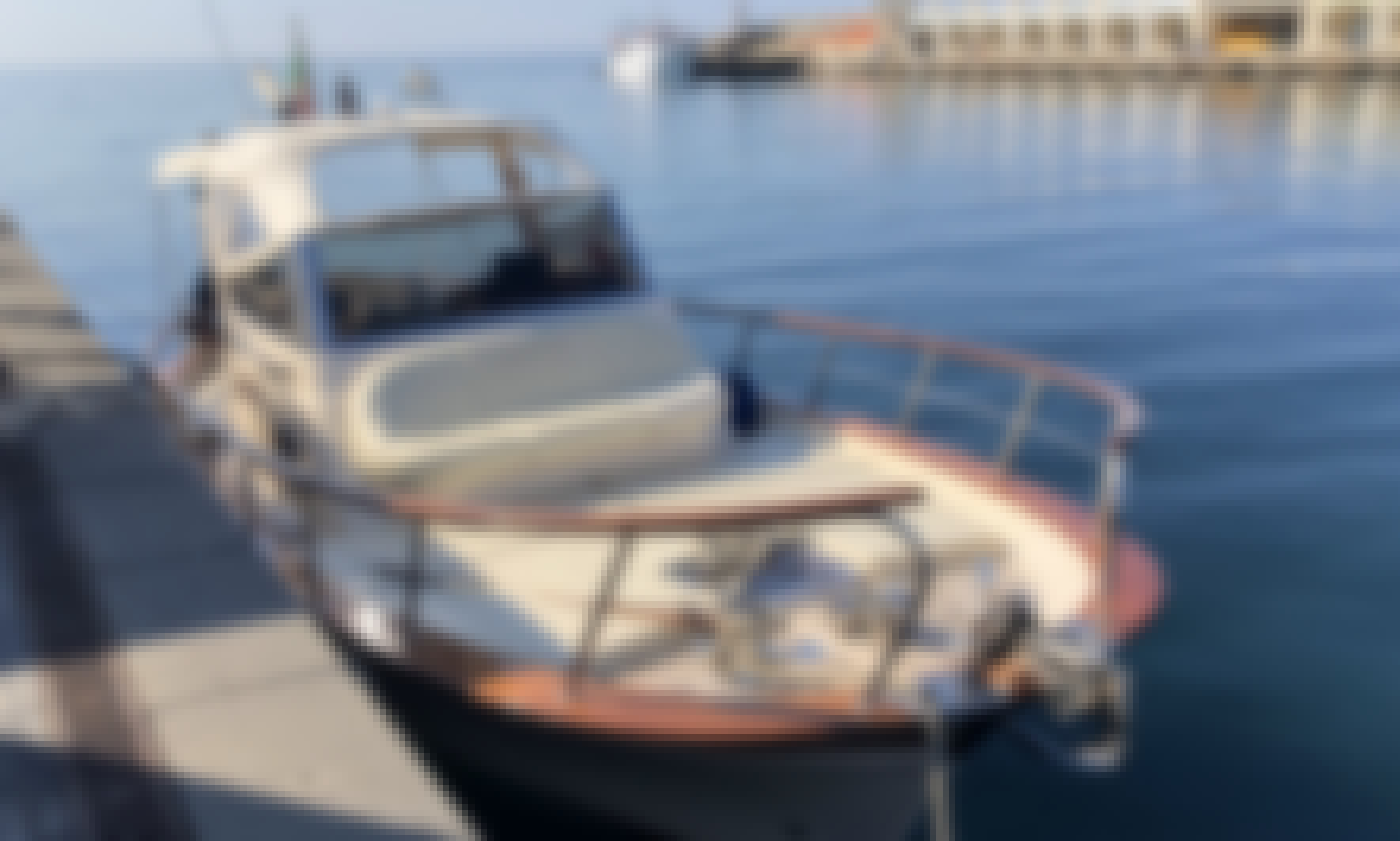 Charter this classic power boat for 7 guests to explore Sorrento and the Almafi Coast