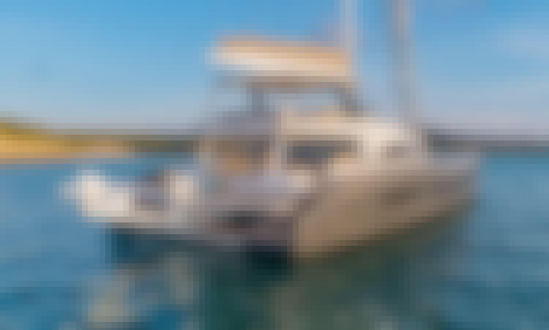 "Hit the water in Phuket, Thailand with ""Joy"" Lagoon Seventy 7 Cruising Catamaran"