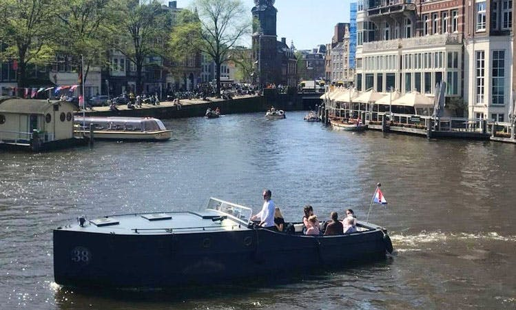 Charter a Canal Boat with up to 12 people in Amsterdam