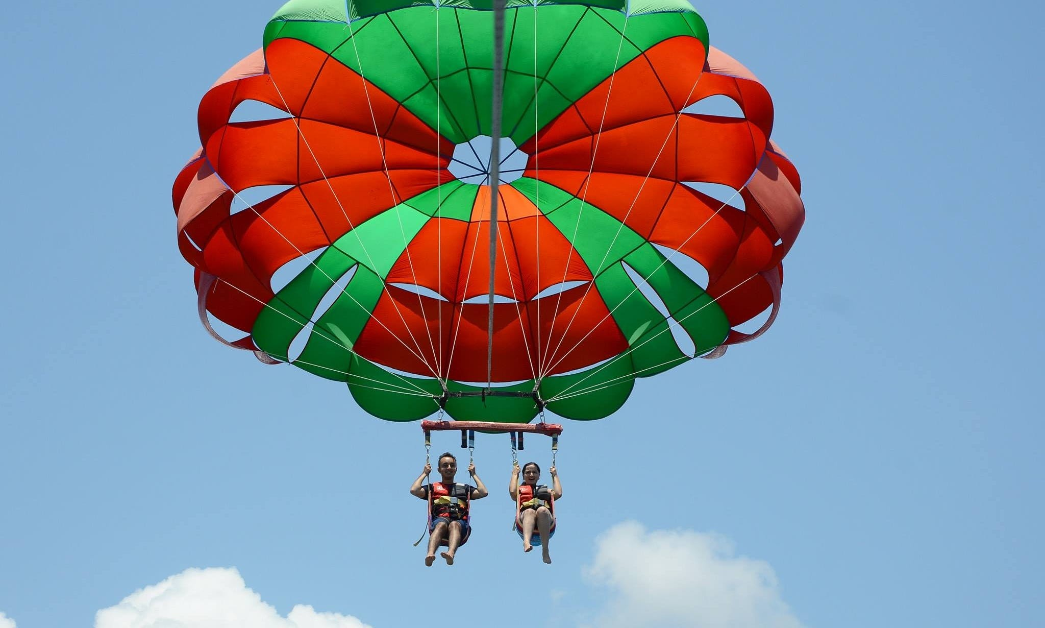 Enjoy An Exciting Parasailing Adventure In Kuta Selatan, Indonesia!