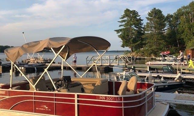 Luxury Pontoon Bennington boat on Lake Kabetogama in Voyageurs National Park Northern Minnesota