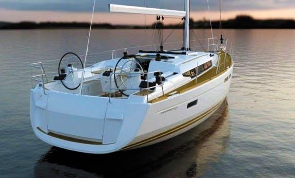 Sailing Holiday On a Luxurious Sun Odyssey 479 Catamaran In Olbia, Sardinia