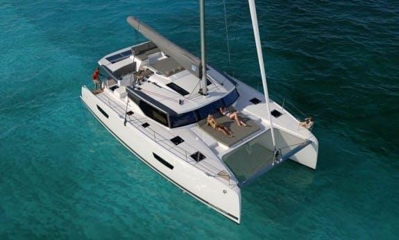 Charter The 47' Saona Cruising Catamaran In Baie Sainte Anne, Seychelles