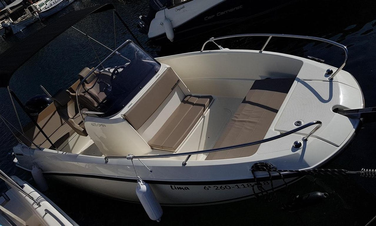 Rent a Quicksilver Activ 605 with a Capacity of 7 People in Es Pelats, Spain