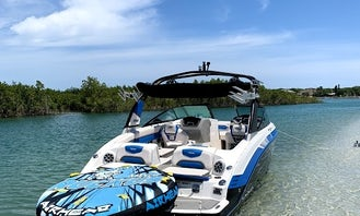 Tubing & Wakeboarding Behind a Jet Boat
