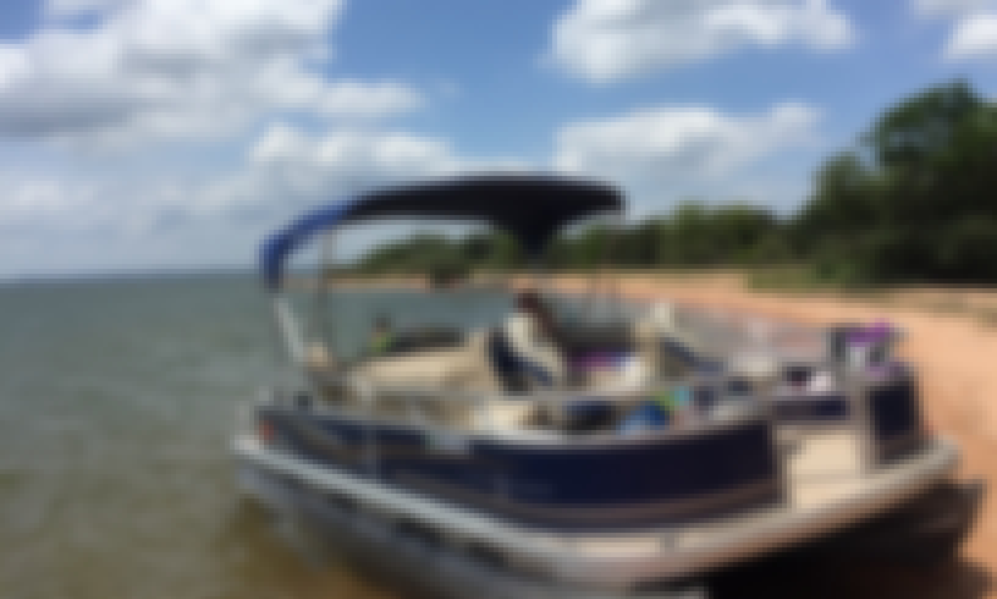 Sun Tracker 20 Barge Pontoon for Fun on Central Texas with Tube and Wakeboard