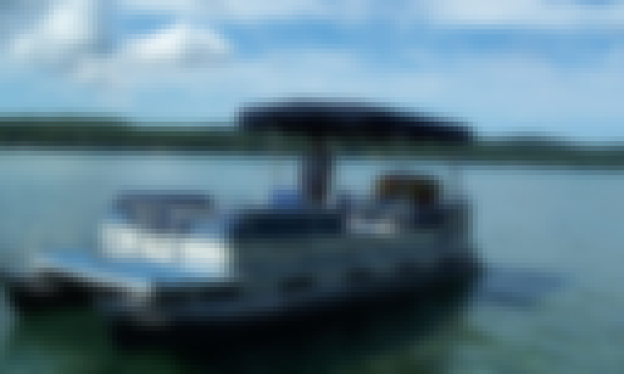 Rent and Drive a 6-8 Person Aqua Patio Executive Cruiser on Glen Lake in Empire, Michigan