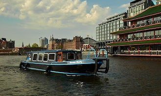 Tour in Amsterdam Canals onboard a Private Covered Boat for 12 People!