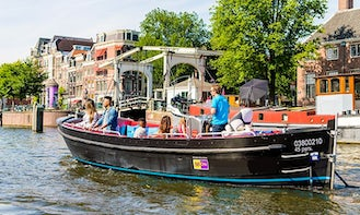 Skippered Private Boat - Stylish, Black, Electric Sloop for 40 People in Amsterdam, Netherlands!