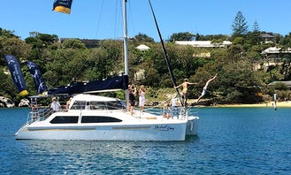 Captained Charter on Perfect Day with a luxury 34 foot Catamaran around Sydney Harbour. Maximum 20 guests
