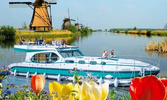 Cruise the Meuse river and the Waal river on 49' Octo Fly Canal Boat  in Kerkdriel
