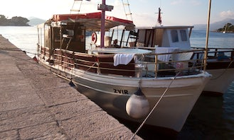 Traditional Wooden Boat for Private Tours in Dubronik with lunch on request and drinks unlimited