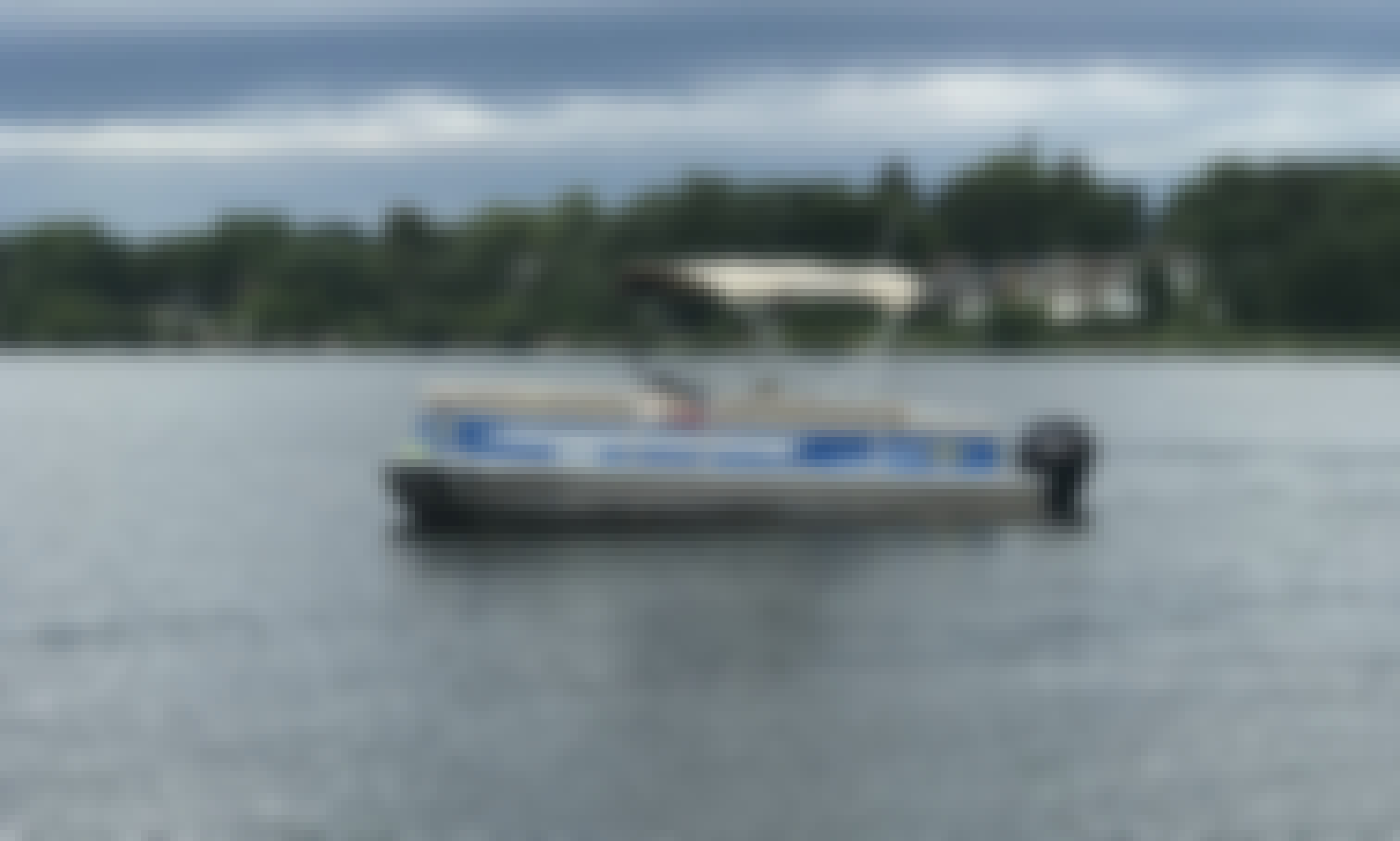 Hire the 22' 115HP Luxury Pontoon boat with 115 hp outboard in Elkhart Lake