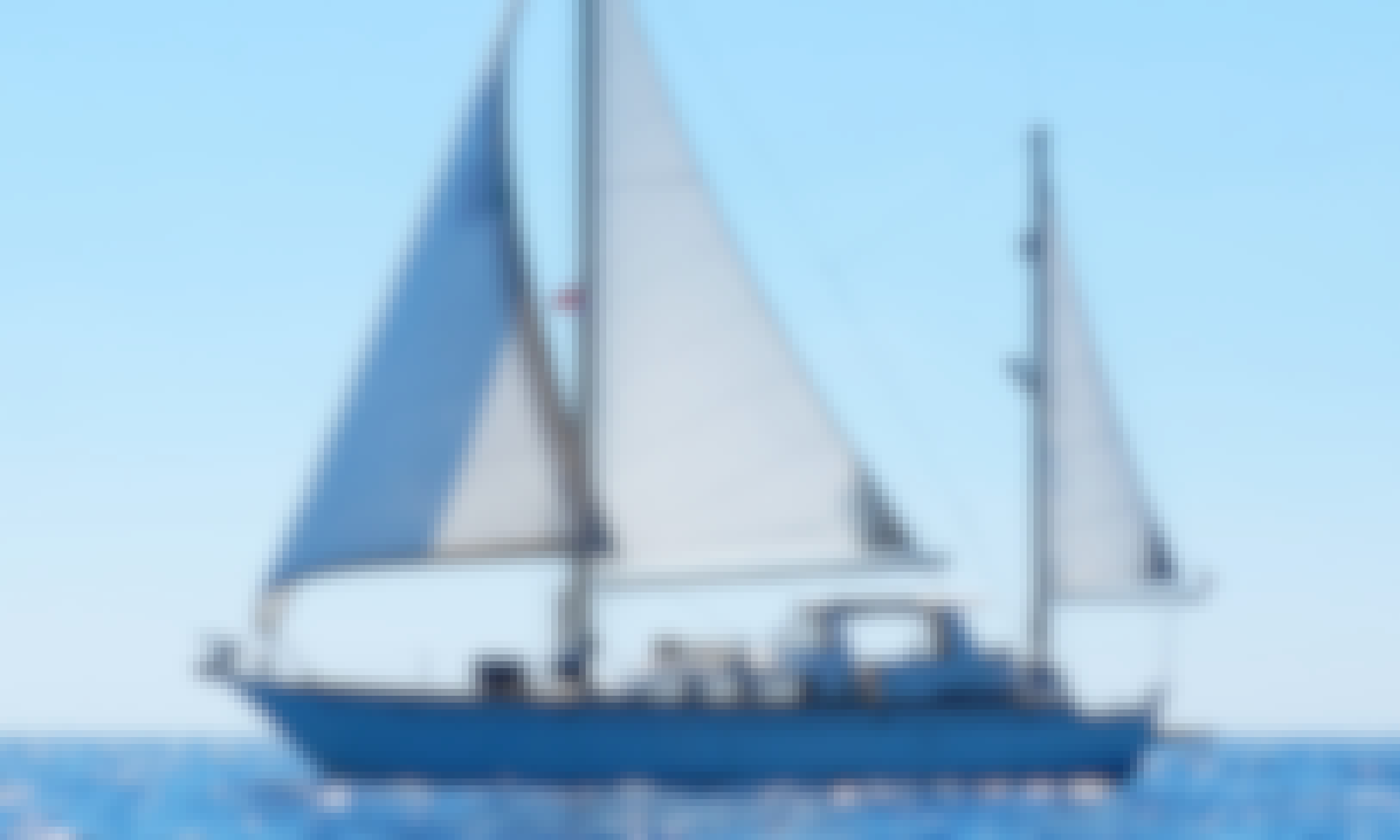 Sail cruising among the Dodecanese islands in Greece