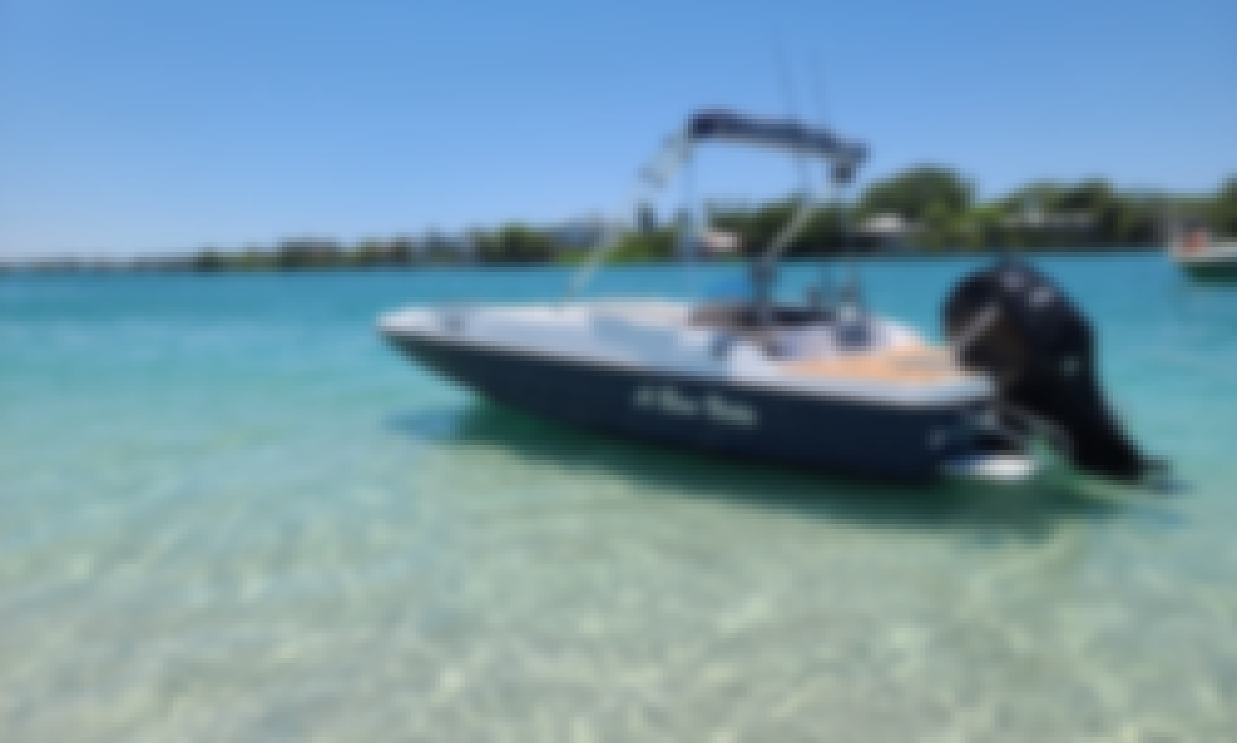Beautiful Deck Boat with ample seating perfect for a family to lounge, fish, swim and tube all day right on Anna Maria Island