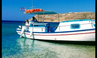 Traditional Wooden Boat for rent in Ornos