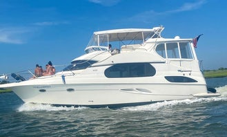 Silverton 43 Motor Yacht Rental in Long Beach, New York Boat Rides / Day-Sunset Cruises Up to 6 Passengers Maximum. Please, No Exceptions!