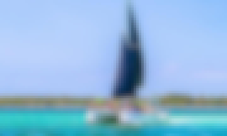 VIP Half Day Aboard 'Bad Girl' Catamaran - Open Bar & Natural Pool & Snorkeling