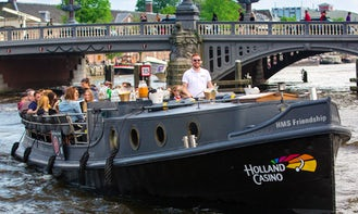 Book the 'HMS Friendship Canal Boat' in Amsterdam, Netherlands (100% electric)