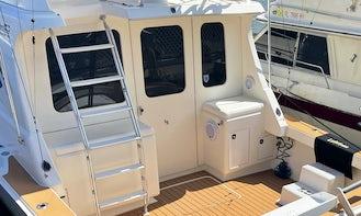 38' Luhrs Sport Fisherman , cruiser . 6 people max . Sand bar , reefs , snorkeling , sunset cruise .