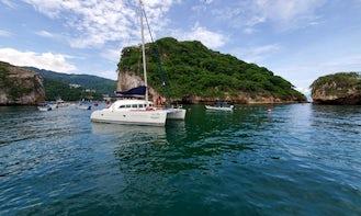 See the wonders of Puerto Vallarta aboard 38' Sailing Catamaran Charter