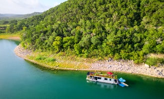 Spend the night aboard a 55' Houseboat-Yacht in a Secluded Lake Travis Cove